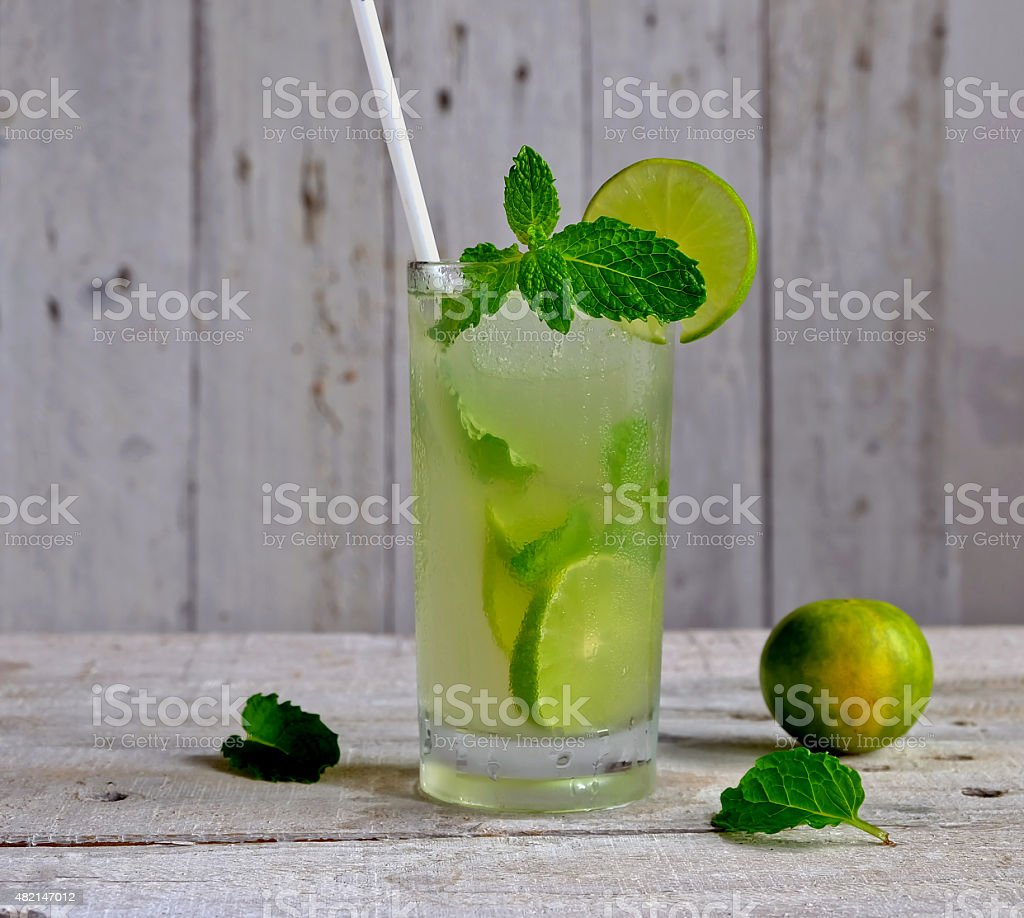 freshly lime juice on wooden background stock photo
