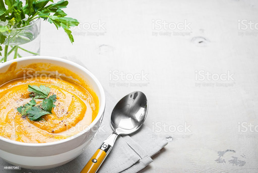Freshly made and ready to eat pumpkin soup with parsley stock photo