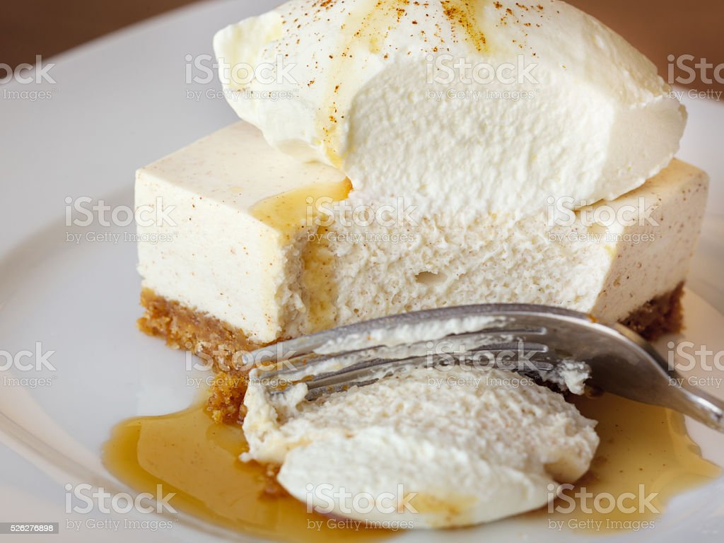 Freshly made cheesecake with whipped cream and caramel stock photo