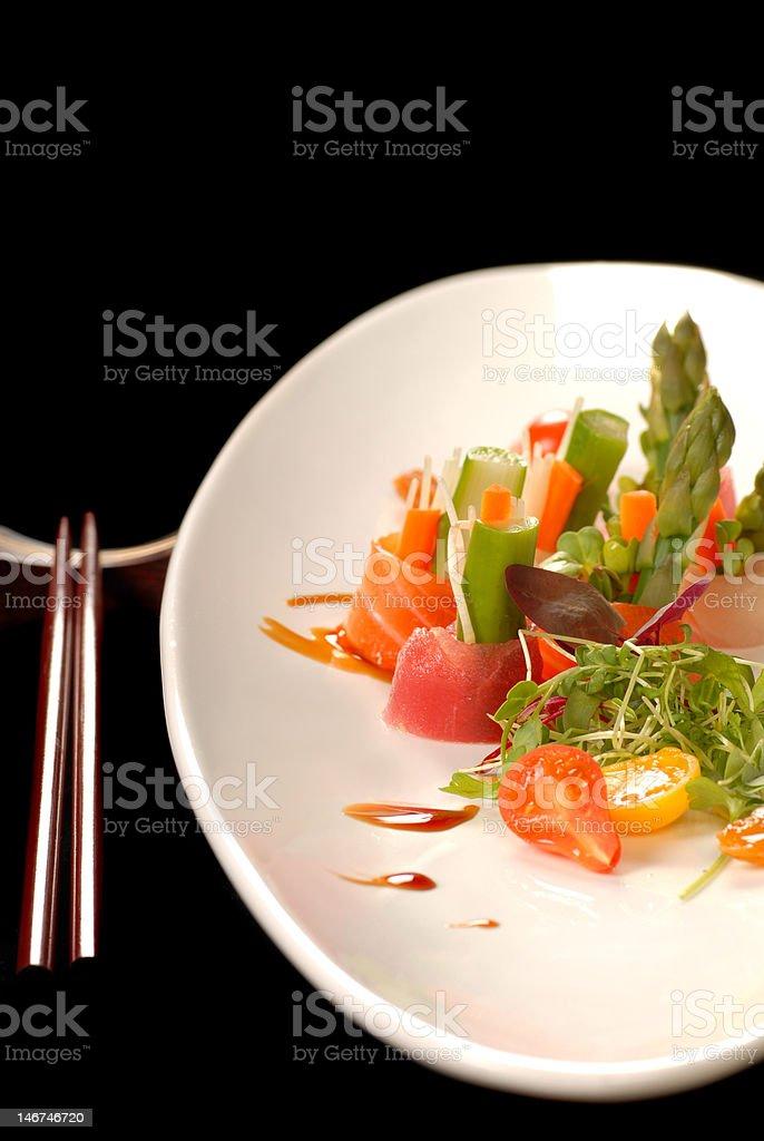 Freshly made japanese sashimi with chop sticks royalty-free stock photo