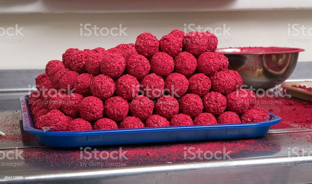 Freshly made white chocolate truffles with raspberry. stock photo