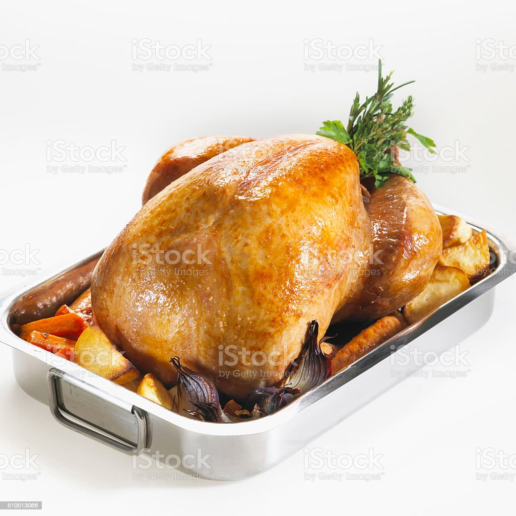 Freshly oven roasted turkey in an oven dish. stock photo