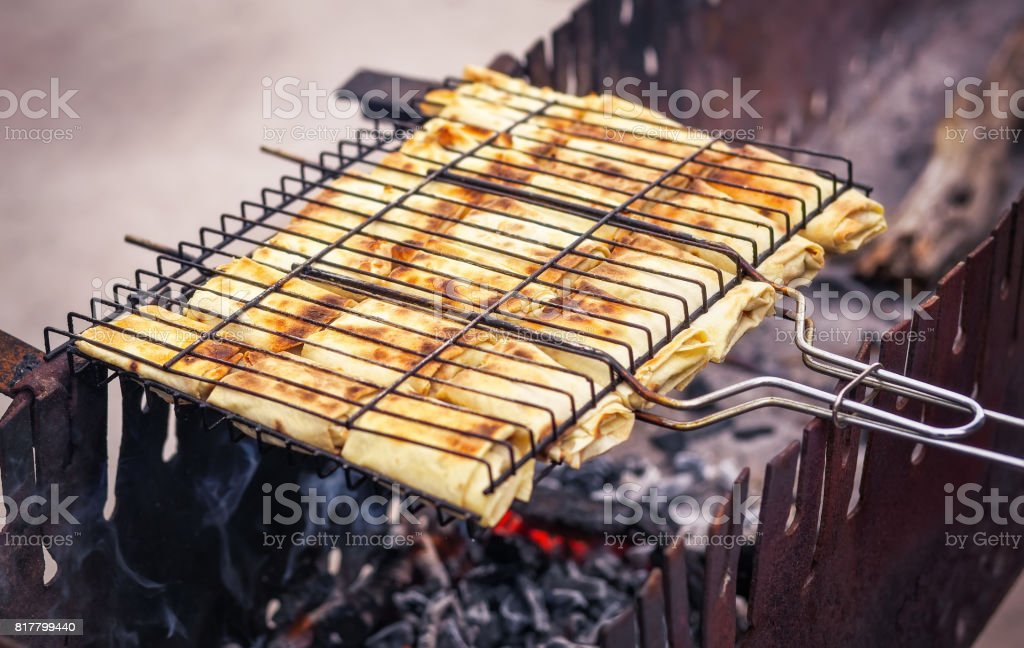 Freshly pancakes with filling, roasted on the grill. stock photo