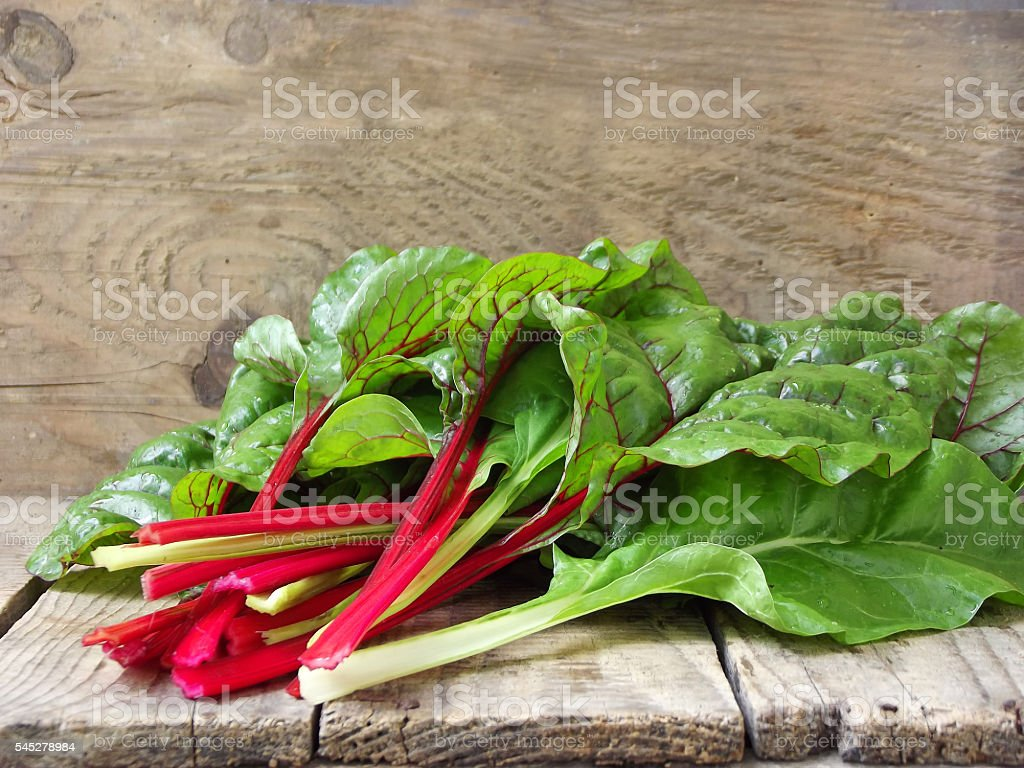 Freshly picked green and red colored swiss chard stock photo