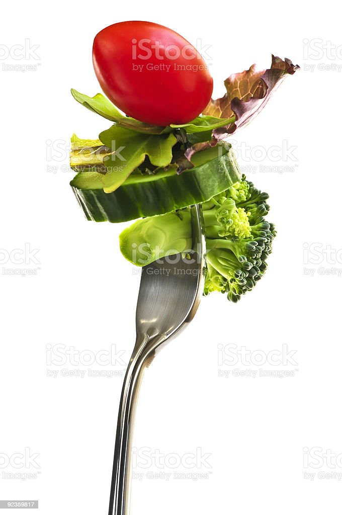 Freshly picked salad vegetables on a fork royalty-free stock photo