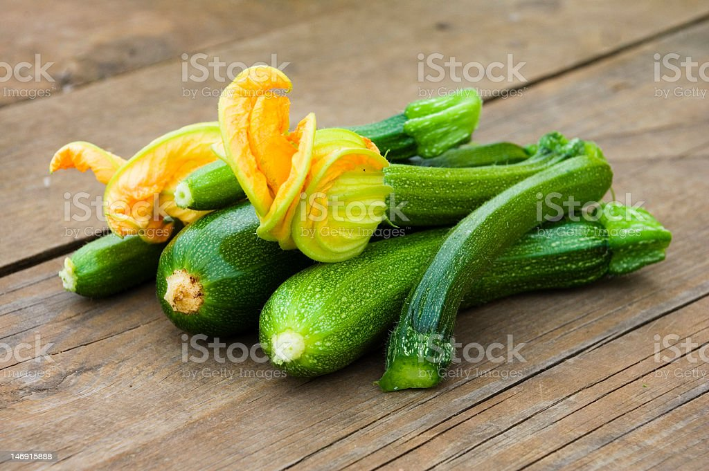 Freshly picked zucchinis with flowers stock photo