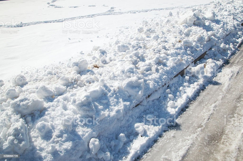 Freshly plowed snow on the edge stock photo