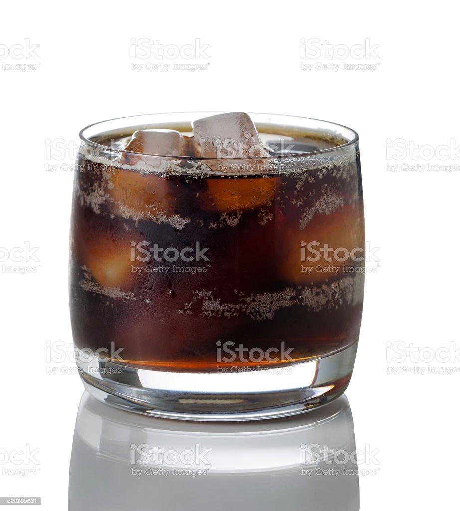 Freshly poured dark soda with ice in glass stock photo