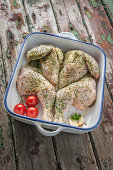 Freshly prepared spatchcock chicken in baking dish