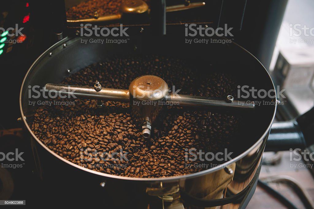 freshly roasted coffee beans n a coffee roaster stock photo