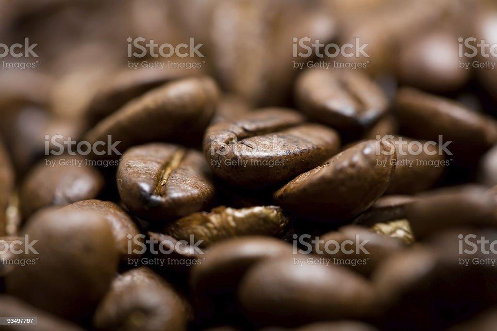 Freshly roasted coffee beans on sackcloth stock photo