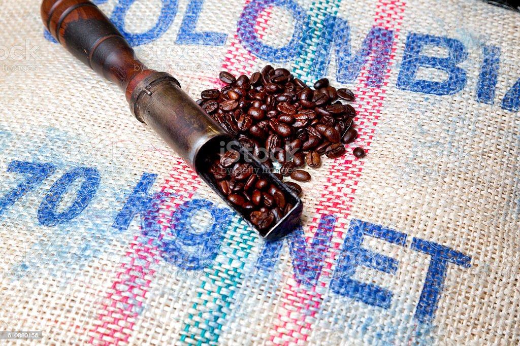 Freshly Roasted Gourmet Coffee Beans on Burlap Sack stock photo