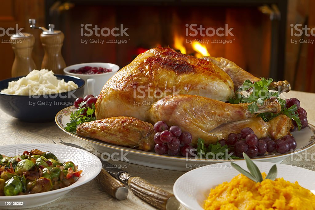 Freshly roasted turkey dinner with vegetables in bowls royalty-free stock photo