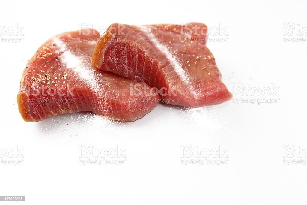 Freshly salted and peppered tuna steaks stock photo