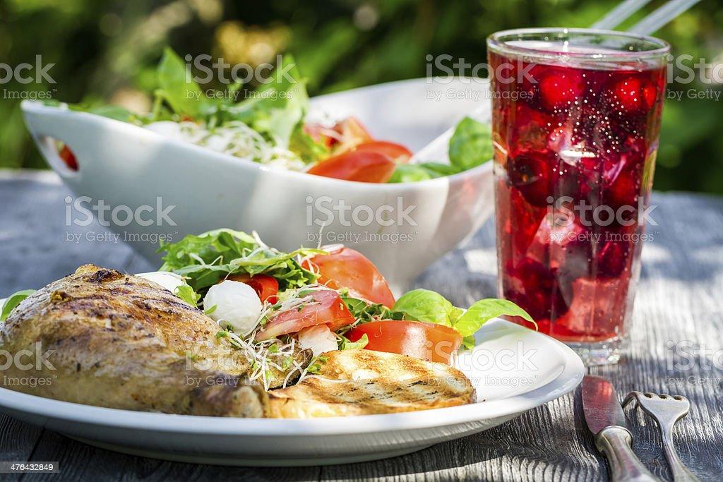 Freshly served dinner in the garden stock photo