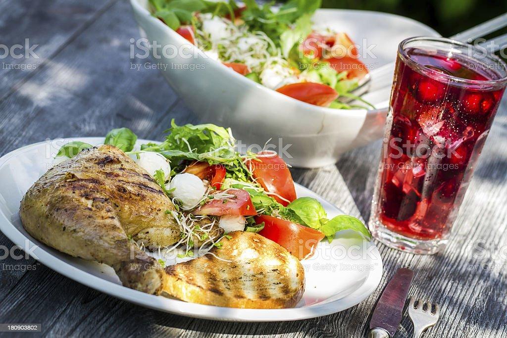 Freshly served dinner in the summer garden stock photo