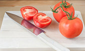 Freshly sliced tomato with knife
