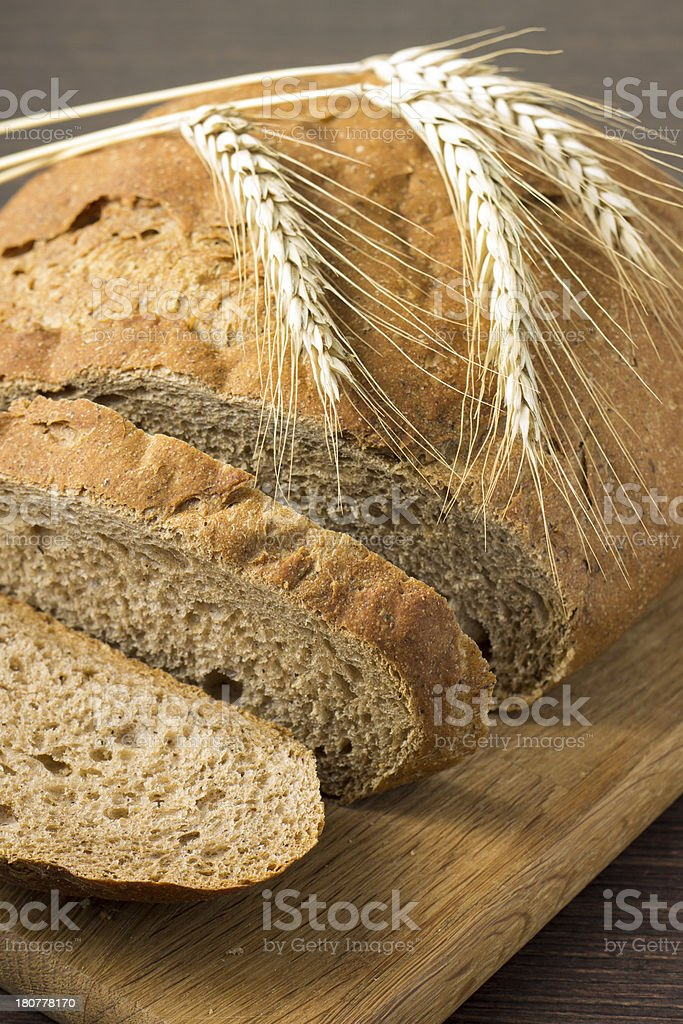 Freshly sliced  wheat bread with ears royalty-free stock photo