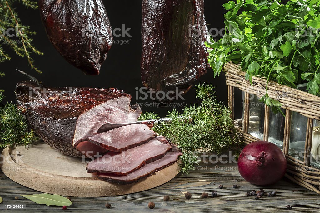 Freshly smoked ham in a rural pantry royalty-free stock photo