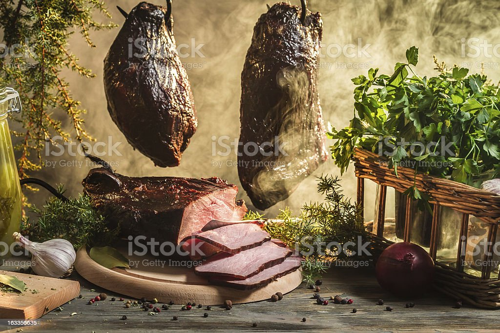 Freshly smoked ham in country smokehouse royalty-free stock photo