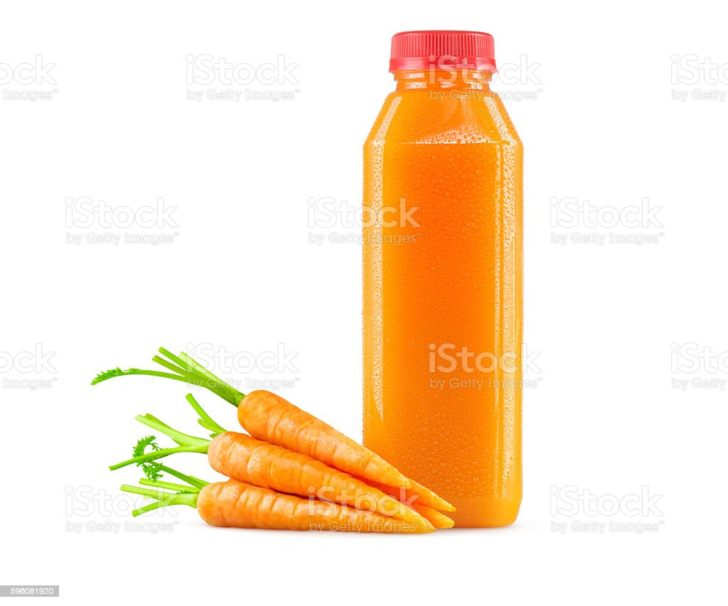 Freshly Squeezed Carrot Juice in Bottle on White Background stock photo