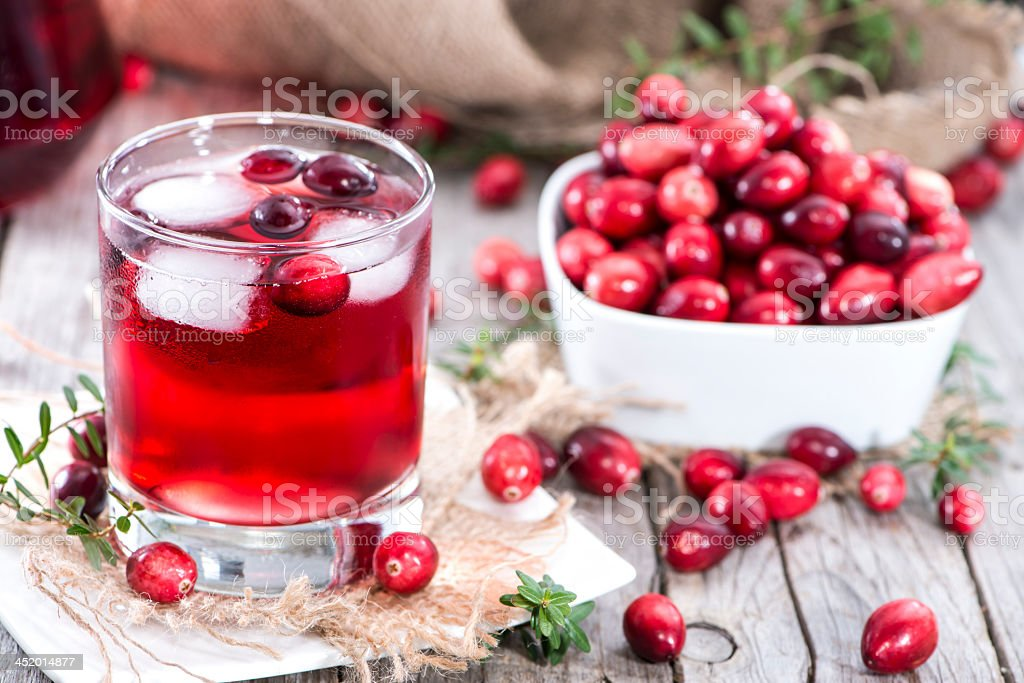 Freshly squeezed cranberry juice and fresh cranberries stock photo