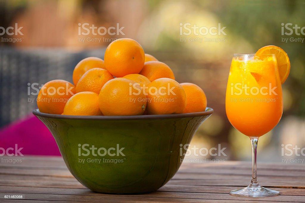 Freshly Squeezed Non-Alcoholic Majorca Orange Juice with Orange Fruit Bowl stock photo