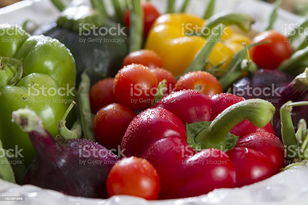 Freshly washed, colorful vegetables in a white ceramic bowl. stock photo
