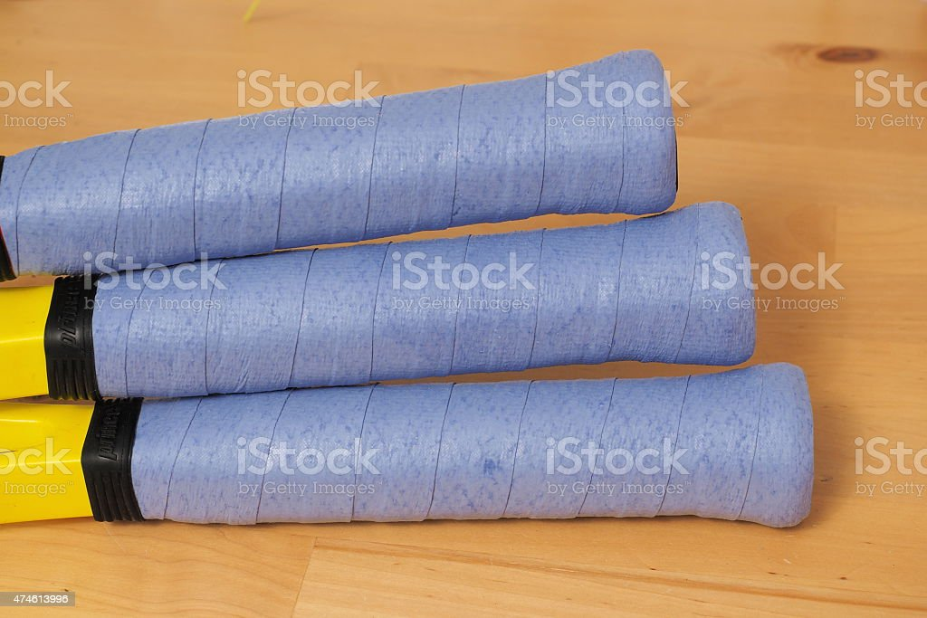 Freshly wrapped blue over grips on 3 Tennis rackets stock photo