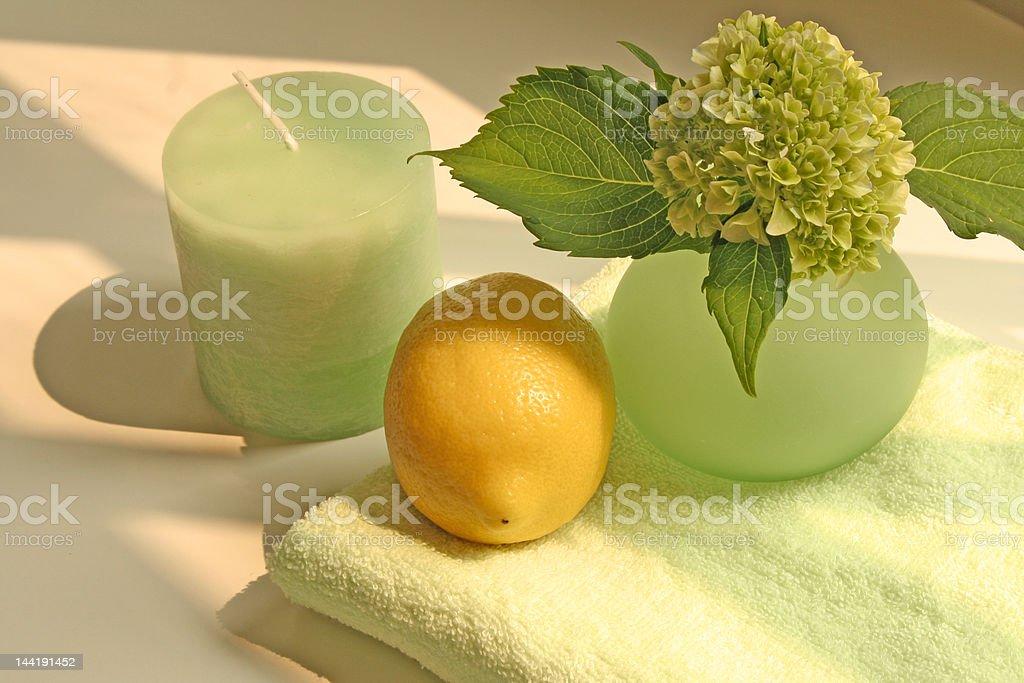 Freshness: candle, lemon, vase with flower and towel royalty-free stock photo