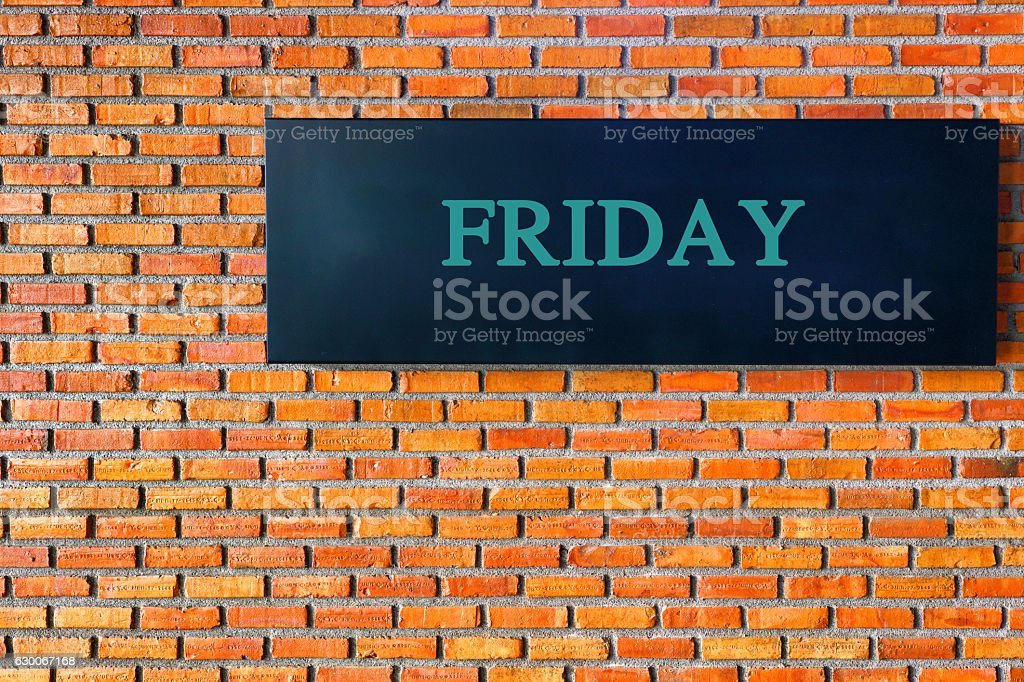 Friday letters on a black background with  brick wall stock photo
