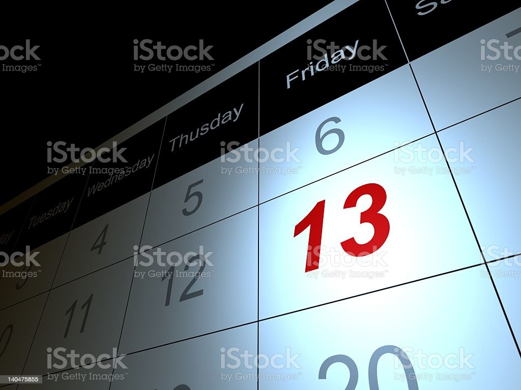 Friday the 13 date in red on calendar stock photo