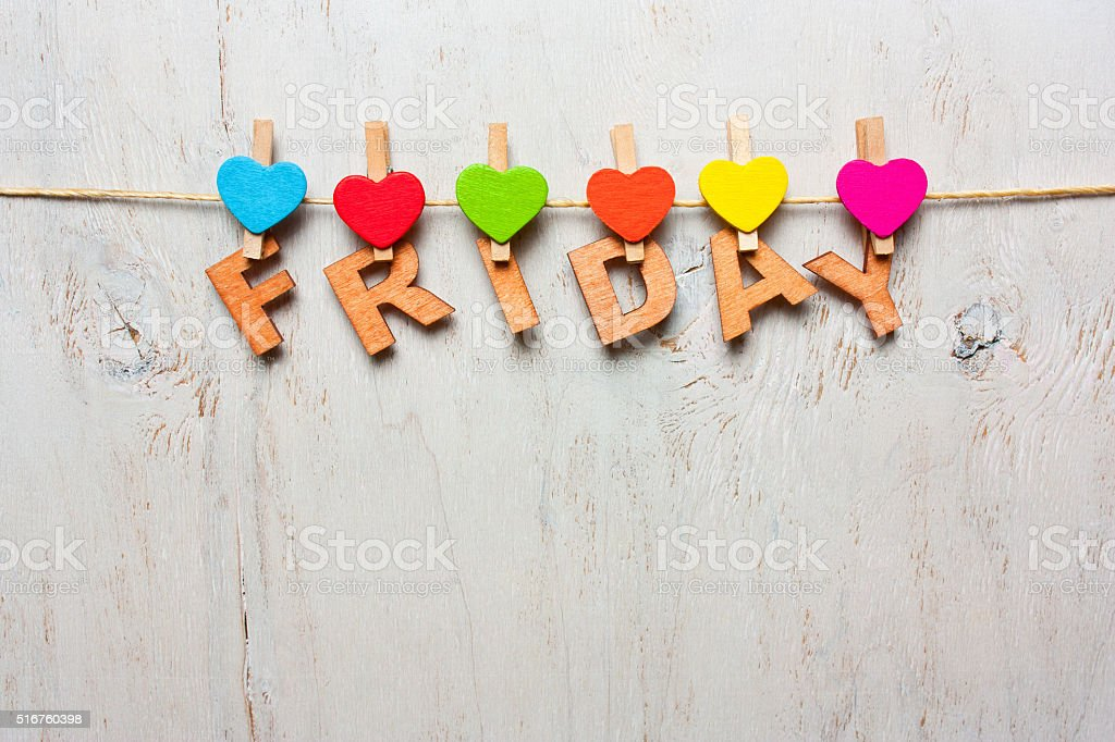 Friday word from wooden letters on a white wooden background stock photo