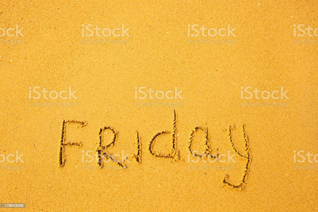 Friday - written in sand on beach texture royalty-free stock photo