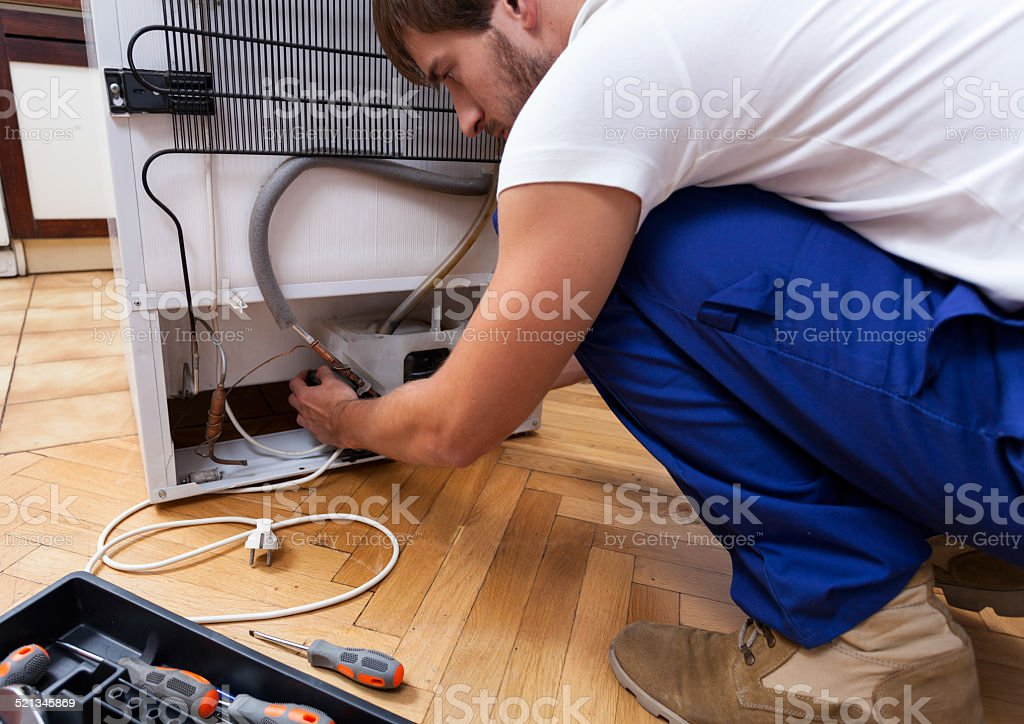 Fridge doesn't work well stock photo
