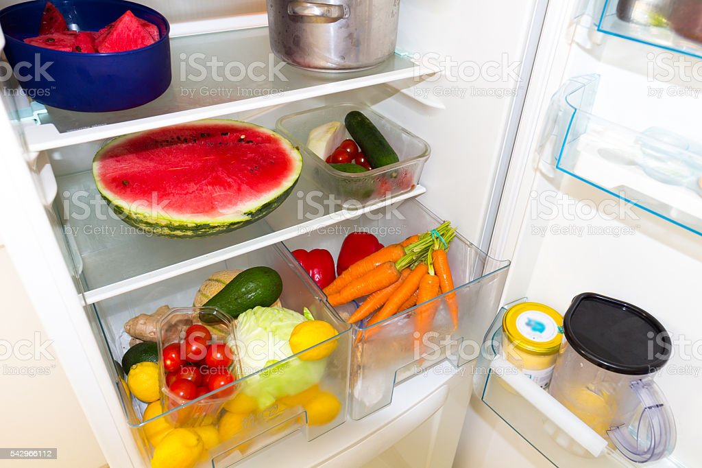 Fridge filled with fruits and vegetables stock photo
