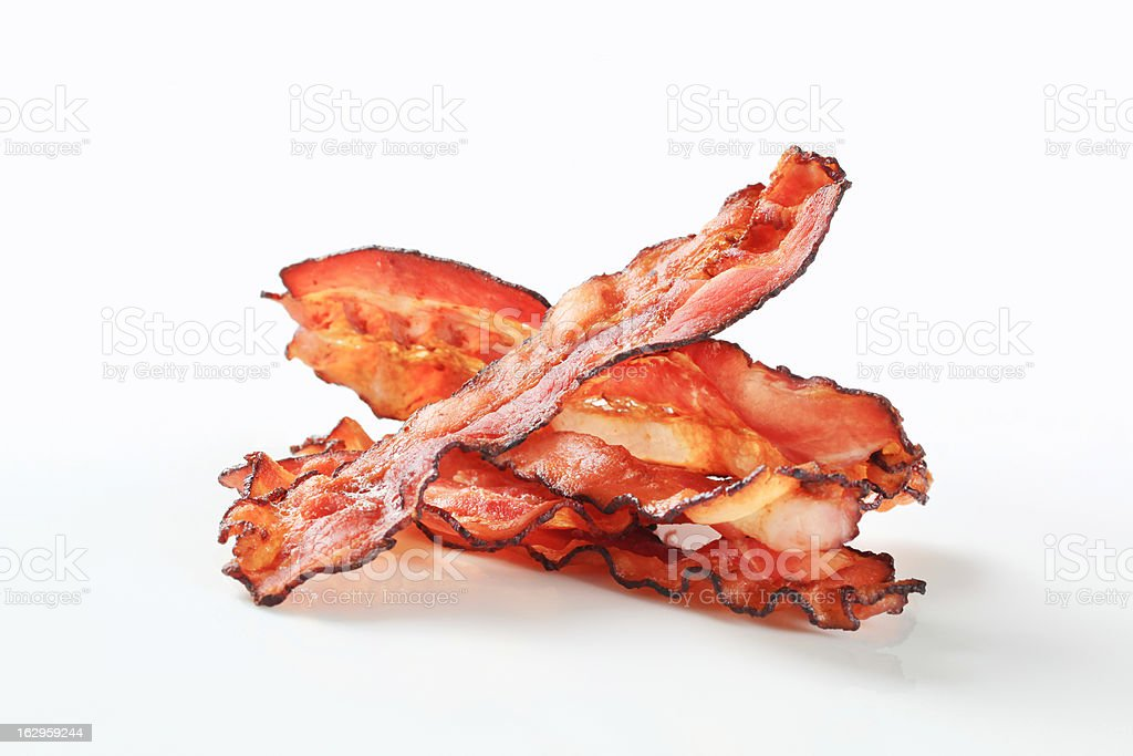 Fried bacon strips stock photo