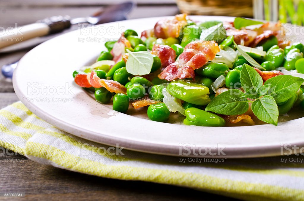 Fried bacon with vegetables stock photo