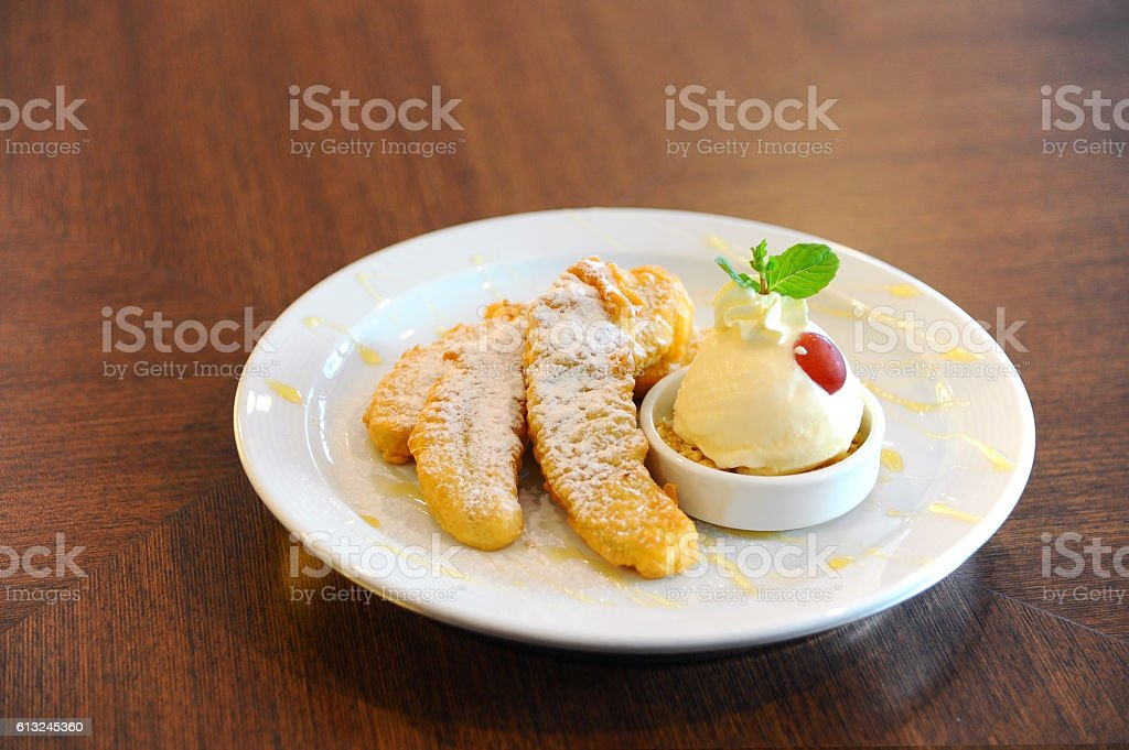 fried bananas with ice cream place in plate stock photo