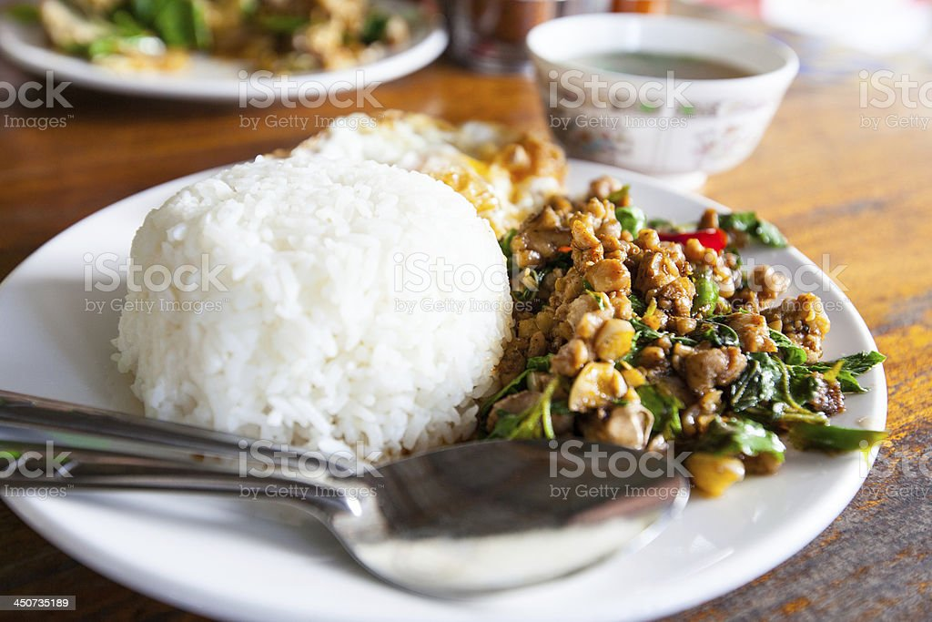Fried basil leave with chicken on rice. royalty-free stock photo