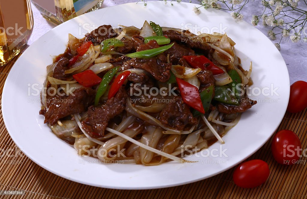 Fried beef and pepper on flat rice noodle (豉椒牛河) stock photo