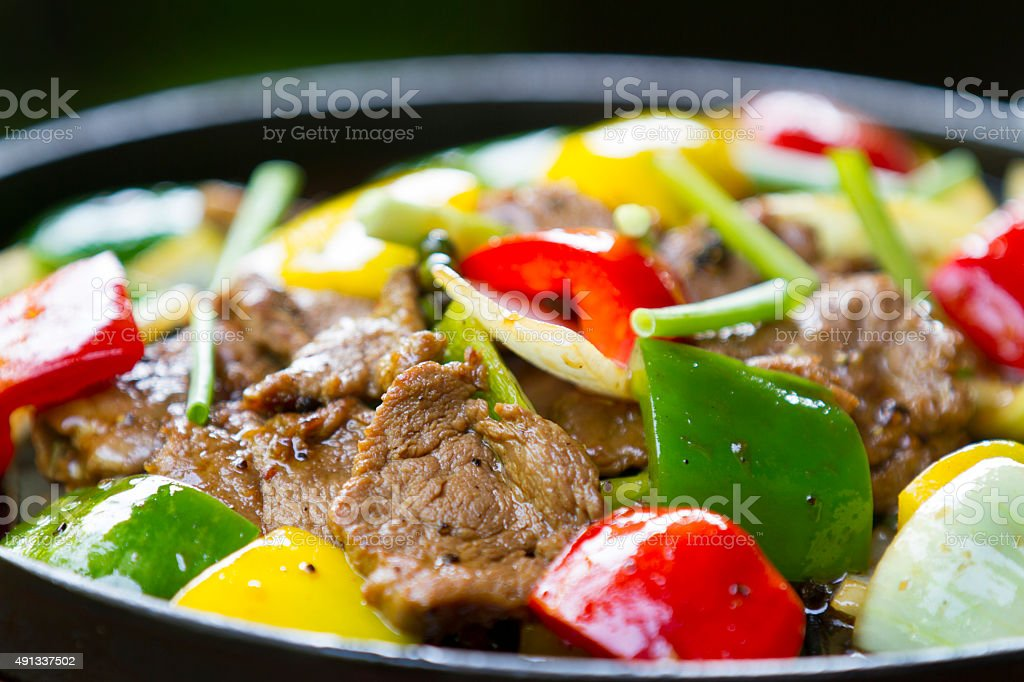 fried beef with bell pepper stock photo