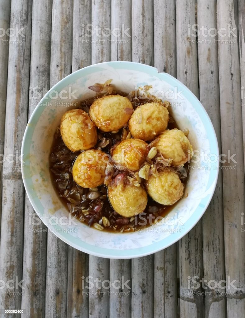 Fried Boiled Egg with Tamarind Sauce. A Thai style food,Son-in-Law Eggs. stock photo