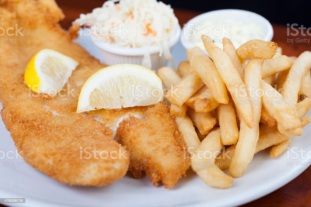 Fried breaded fish with french fries stock photo