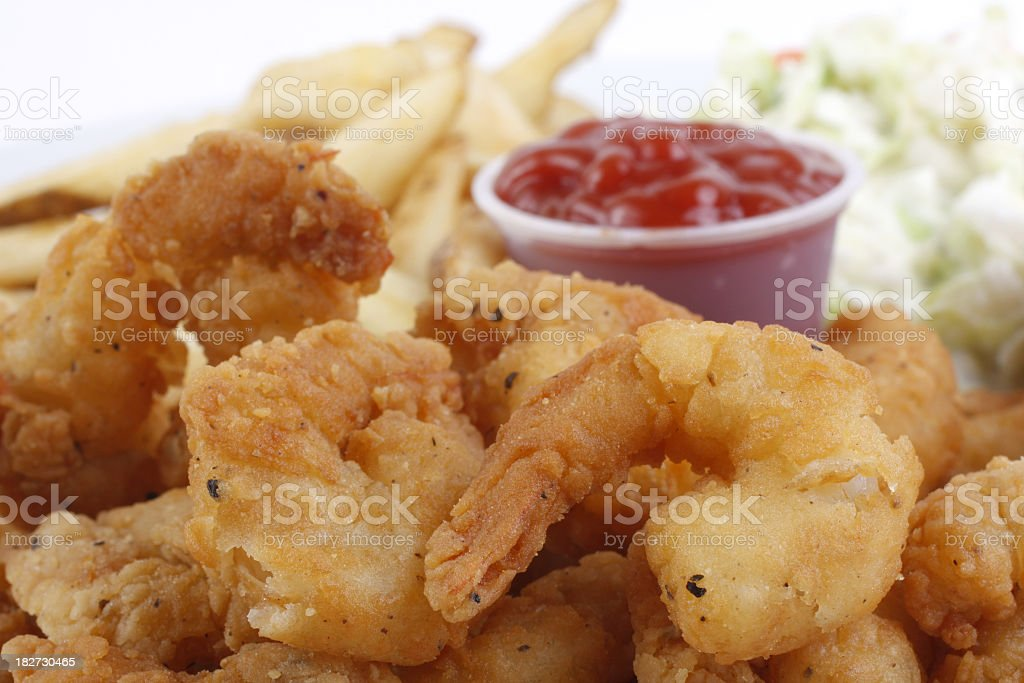 Fried breaded shrimp with fries and ketchup dip stock photo
