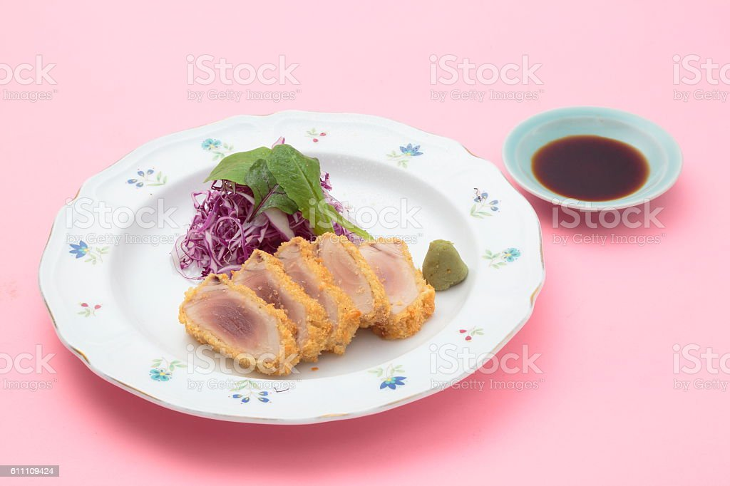 Fried breaded tuna with salad, wasabi and soy sauce on stock photo