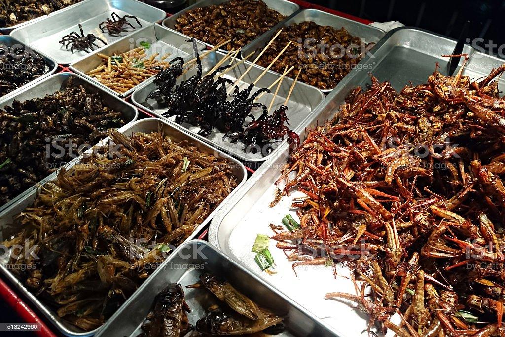 Fried Bugs in Bangkok night market stock photo