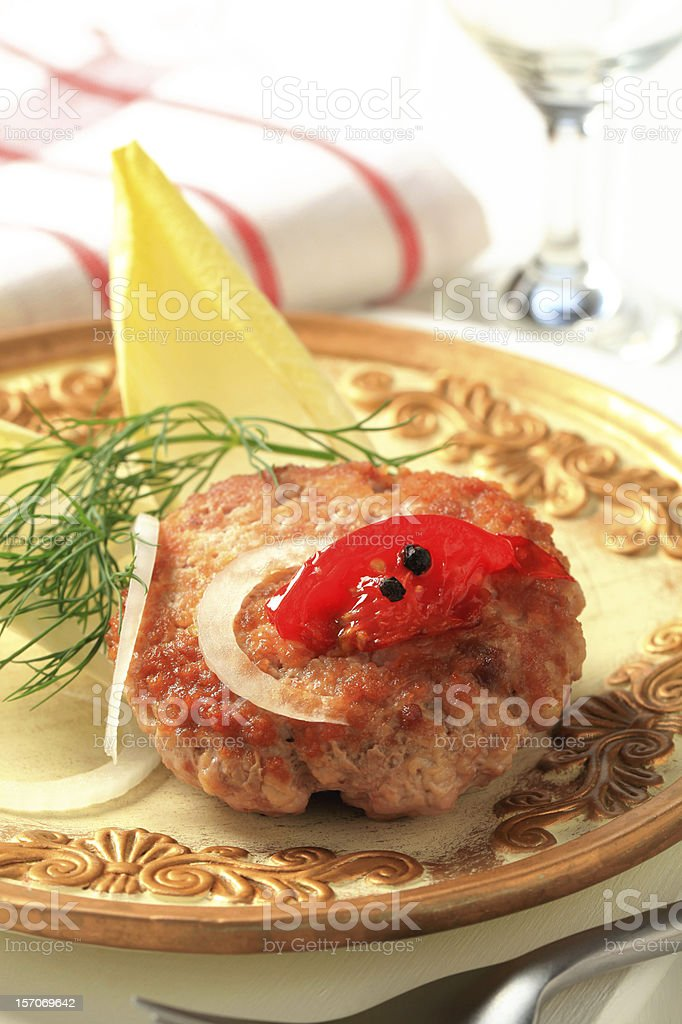 Fried burger and endive leaves royalty-free stock photo
