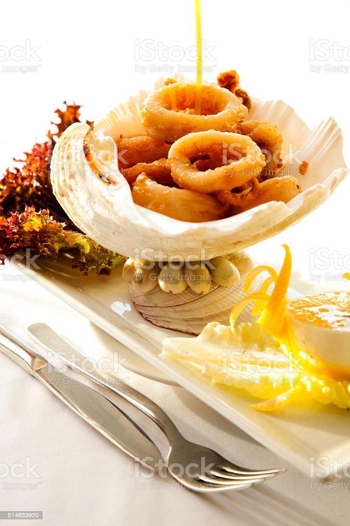 Fried Calamari or squid in sea shell stock photo