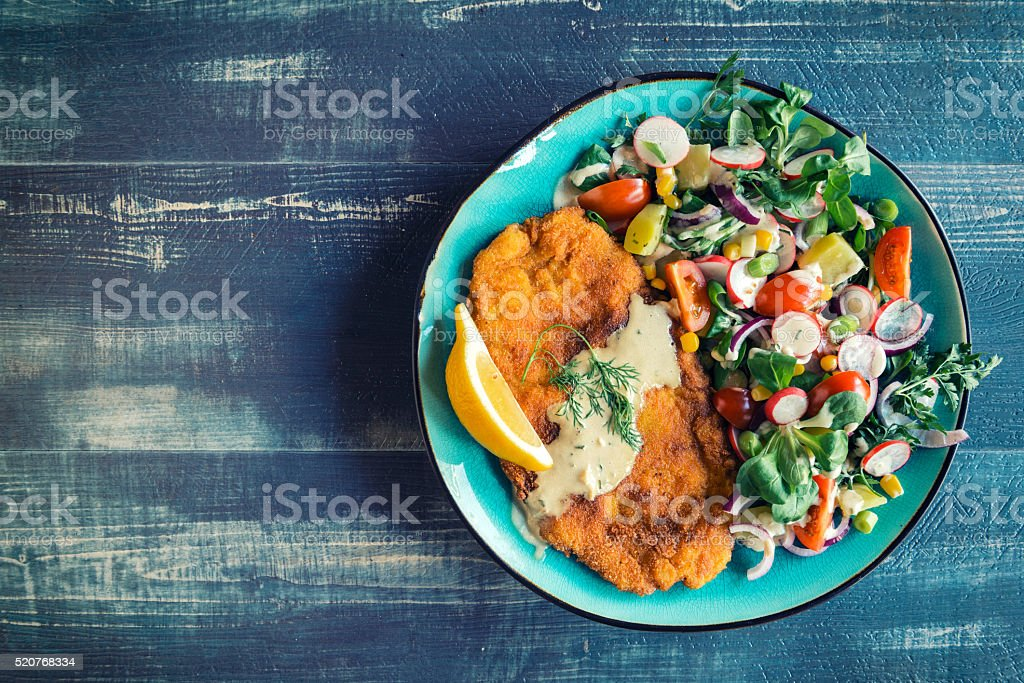 Fried catfish and salad stock photo